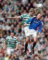 Photo. Jed Wee.Digitalsport<br /> Glasgow Celtic v Glasgow Rangers, Scottish FA Cup, Celtic Park, Glasgow. 07/03/2004.<br /> Celtic's Stanislav Varga (L) wins a header from Rangers' Stephen Hughes.