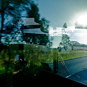 Aboard a greyhoung coach on the east coast road of Australia. Through the window