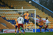 Farrend Rawson of Mansfield Town (6) heads the ball clear  during the The FA Cup match between Mansfield Town and Dagenham and Redbridge at the One Call Stadium, Mansfield, England on 29 November 2020.