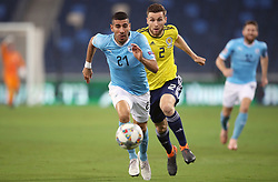 Israel's Eitan Tibi (left) and Scotland's Stephen O'Donnell battle for the ball during the UEFA Nations League Group C1 match at the Sammy Ofer Stadium, Haifa.