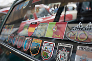 European travel flag stickers on the rear windscreen of a vintage car on show at a monthly meet up in Greenwich Market in London, England, United Kingdom.