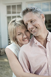 Couple attractive hugging middle aged relaxing