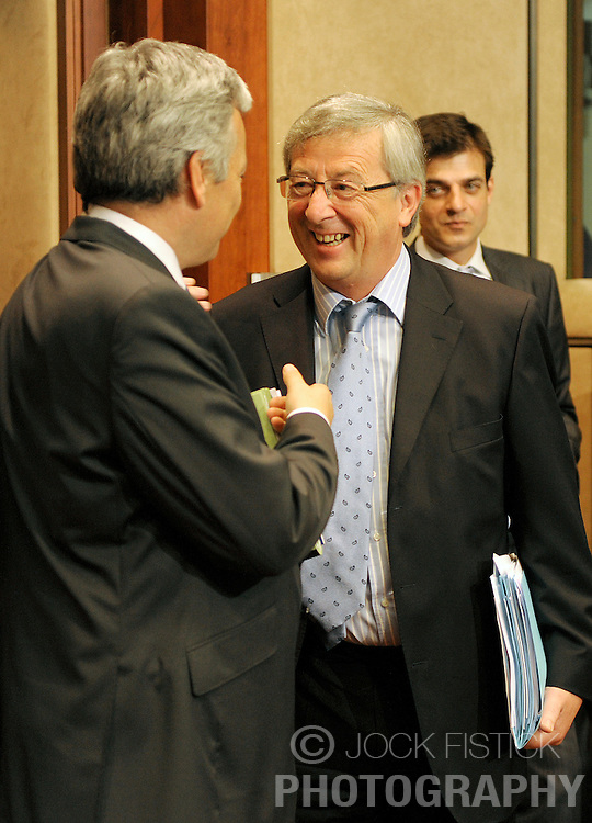 Jean-Claude Juncker, Luxembourg's prime minister, and president of Eurogroup, right, speaks with Didier Reynders, Belgium's finance minister, during the Eurogroup meeting in Brussels, Monday, July 6, 2009. (Photo © Jock Fistick)
