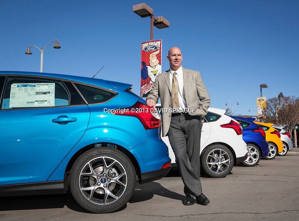 Mike Shell, Fleet Manager at Simi Valley Ford poses by a new Ford Focus at the dealership. The dealership is running a campaign through Earth Day on April 22 in which the company will make a two-year carbon offset donation to carbonfund.org for every car purchased. Shot Feb. 19th,  2013 Photo by David Sprague ©2013