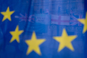 On the day that the EU in Brussels agreed in principle to extend Brexit until 31st January 2020 (aka 'Flextension') and not 31st October 2019, Brexit Party flags and banners are seen through an EU flag during a Brexit protest outside parliament, on 28th October 2019, in Westminster, London, England.