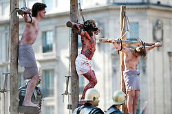 © London News Pictures. 06/04/2012. London, UK.  An actor playing Jesus on the cross (centre) during a performance of  The Passion of Jesus  in front of thousands of people in Trafalgar Square in central London, England on  April 6, 2012  to mark Good Friday. The actors come from the Wintershall Estate in Surrey. Photo credit :  Ben Cawthra/LNP