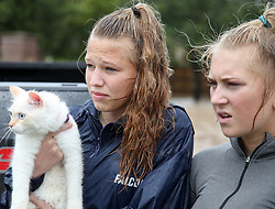 August 29, 2017 - Houston, Texas, U.S. - Volunteers hold a cat that was abandoned during flooding in Katy Grande Lakes. (Credit Image: © John Glaser/CSM via ZUMA Wire)