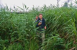 J. & Dana Nichols Walking Through Rice Field Using GPS