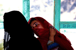 YAFTAL PAYAN, 31 July 2005..Women having a chat at a Vocational Traning Centre.  ....The VTC aim is to make women aware of their onwn status as Mother and as Woman, by giving lessons on maternity, reproductive health, family planning and post-natal issues.....According to United Nations Population Fund, Afghanistan has among the world?s highest rates of maternal mortality, and Badakhshan has the highest rates ever recorded anywhere in the world, with one mother dying in every 15 births. Underage marriage is one of the primary causes of maternal mortality.....The VTC is funded by UNFPA and implemented by IBNSINA.