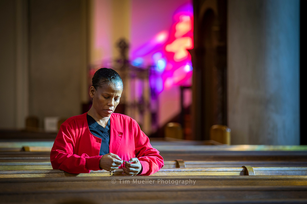 Sacred Heart of Jesus parishioner Dianna prays the rosary after a week-day Mass at the church.