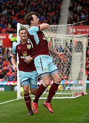 Burnley's Ashley Barnes celebrates scoring his side's first goal of the game during the Premier League match at the bet365 Stadium, Stoke.
