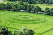1630 King's Knot garden & tournament field. Stirling, Scotland, United Kingdom, Europe. Once the capital of Scotland, Stirling is visually dominated by Stirling Castle, in the United Kingdom, Europe. Historically, Stirling controlled a strategic position (until the 1890s) as the lowest bridging point of the River Forth before it broadens towards the Firth of Forth, making it the gateway to the Scottish Highlands. One of the principal royal strongholds of the Kingdom of Scotland, Stirling was created a royal burgh by King David I in 1130. Stirling Castle sits atop Castle Hill, an intrusive crag, which forms part of the Stirling Sill geological formation. Most of the stronghold's main buildings date from the 1400s and 1500s, when it peaked in importance. The outer defences fronting the town date from the early 1700s. Before the union with England, Stirling Castle was also one of the most used of the many Scottish royal residences, serving as both a palace and a fortress. Several Scottish Kings and Queens have been crowned at Stirling, including Mary, Queen of Scots in 1542, and others were born or died there. Stirling Castle has suffered at least eight sieges, including several during the Wars of Scottish Independence, with the last being in 1746, when Bonnie Prince Charlie unsuccessfully tried to take the castle.