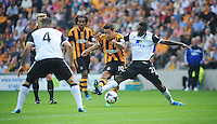 Hull City's Robert Koren vies for possession with Norwich City's Alexander Tettey<br /> <br />  (Photo by Chris Vaughan/CameraSport) <br /> <br /> Football - Barclays Premiership - Hull City v Norwich City - Saturday 24th August 2013 - Kingston Communications Stadium - Hull<br /> <br /> © CameraSport - 43 Linden Ave. Countesthorpe. Leicester. England. LE8 5PG - Tel: +44 (0) 116 277 4147 - admin@camerasport.com - www.camerasport.com