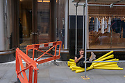 A contractor rests on foam scaffolding collars on Covid 'Freedom Day', the date that Prime Minister Boris Johnson's UK government has set as the end of strict Covid pandemic social distancing conditions with the end of mandatory face coverings in shops and public transport, on 19th July 2021, in London, England.