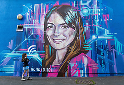 Edinburgh Science Festival, Edinburgh, Scotland, United Kingdom: <br /> Pictured: Valentina Maia, aged 6 years admires the portrait by graffiti and mural artist Shona Hardie of Natalie Duffield, one of the artworks in a street art trail called 'Women in STEM' which showcases the achievements of nine women who have contributed to the world of Science, Technology, Engineering and Maths (STEM). Natalie Duffield is CEO of InTechnology SmartCitie, a company that provides free WiFi in central Edinburgh. Shona has also painted many of the other portraits in the trail which are displayed in venues across the city. <br /> The 2021 Edinburgh Science Festival runs from 26 June – 11 July.<br /> Sally Anderson | EdinburghElitemedia.co.uk