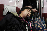 portrait of Asian man during a commuting nap