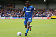 AFC Wimbledon defender Deji Oshilaja (4) dribbling during the EFL Sky Bet League 1 match between AFC Wimbledon and Coventry City at the Cherry Red Records Stadium, Kingston, England on 11 August 2018.