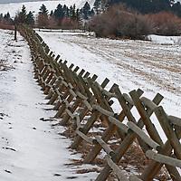A jack leg fence borders wheat fields south of Bozeman, Montana.