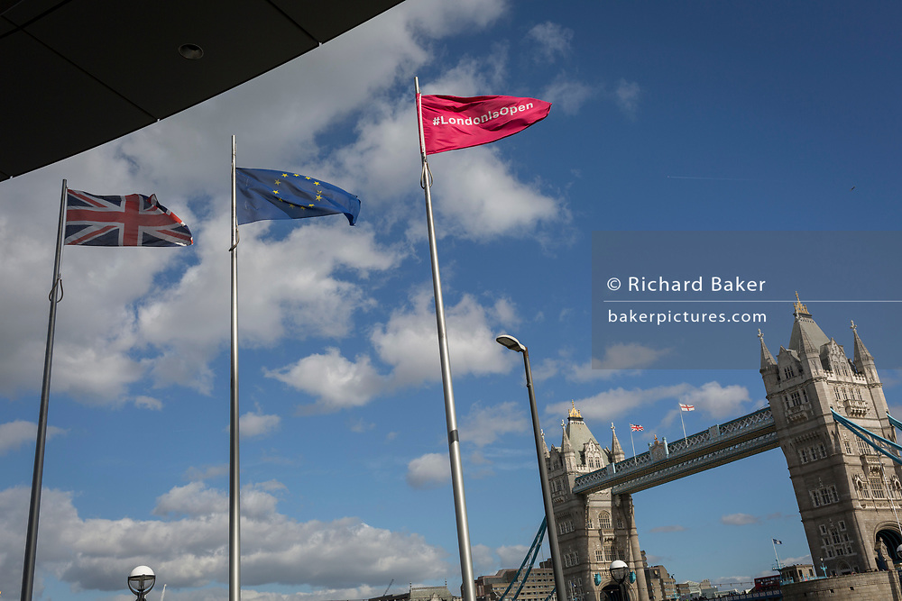 The Union Jack, the EU and a flag saying London is open fly at City Hall with Tower Bridge in the distance on 5th October, 2017, in London, England.