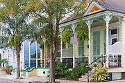 Traditional clapboard creole cottage home and stars and stripes flag in Faubourg Marigny historic district  of New Orleans, USA