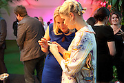 LIZ MATHEWS; PIXIE GELDOF, Glamour Women of the Year Awards 2011. Berkeley Sq. London. 9 June 2011.<br /> <br />  , -DO NOT ARCHIVE-© Copyright Photograph by Dafydd Jones. 248 Clapham Rd. London SW9 0PZ. Tel 0207 820 0771. www.dafjones.com.