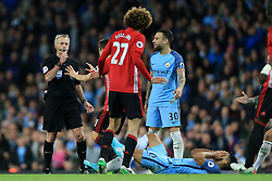 27th April 2017 - Premier League - Manchester City v Manchester United - Referee Martin Atkinson blows his whistle as Sergio Aguero of Man City goes down following an altercation with Marouane Fellaini of Man Utd - Photo: Simon Stacpoole / Offside.