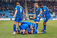 Gillingham FC midfielder Mark Byrne (33) (hidden) scores a goal (1-0) and celebrates with team mates  during the EFL Sky Bet League 1 match between Gillingham and Scunthorpe United at the MEMS Priestfield Stadium, Gillingham, England on 16 February 2019.