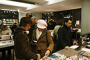 Shopping at the chic, fashionable & stylish 'Colette' shop, rue St.Honoré, in the centre of Paris. The shop has three floors; on the basement is the restaurant; on the ground floor, books, jewellery, cameras and mobile telephones, cd's and dvds, and a bazaar with a bit of everything; on the first floor is ladies and mens clothes.///Shopping at  Colette's