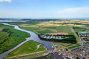 Nederland, Groningen, Gemeente  De Marne, 05-08-2014; Zoutkamp met zeesluis en jachthaven. Voormalig vissersdorp gelegen aan de monding van het Reitdiep in de Lauwerszee, bekend van Heiploeg Garnalen.<br /> Former fishing village, known for Heiploeg Shrimps, port and marina on the Reitdiep, near Lauwers Lake, former Lauwers Sea<br /> <br /> luchtfoto (toeslag op standard tarieven);<br /> aerial photo (additional fee required);<br /> copyright foto/photo Siebe Swart