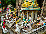02 AUGUST 2018 - PAK KRET, NONTHABURI, THAILAND: Spirit houses in front of a Buddhist temple on Ko Kret. Ko Kret (also spelled Koh Kret) is a small island in the Chao Phraya River in Nonthaburi province north of Bangkok. It is about 2 km long and 1 km wide. It has seven main villages, the largest and most populous being Ban Mon. Ko Kret was created in 1722 when a canal was dug in the Chao Phraya River to bypass a bend. Most of the people on the island are ethnically Mon, from the hills of western Thailand and eastern Myanmar (Burma). The island is popular as a weekend daytrip from Bangkok. The island is famous for the Mon style pottery made on the island.      PHOTO BY JACK KURTZ