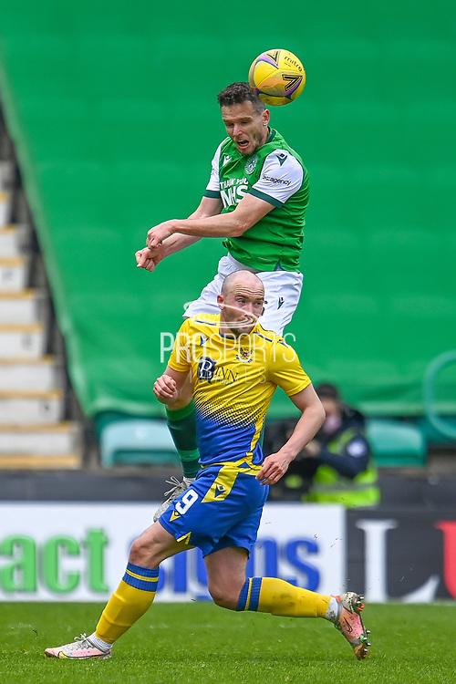 Paul McGinn (#6) of Hibernian FC wins a header against Chris Kane (#9) of St Johnstone FC during the SPFL Premiership match between Hibernian and St Johnstone at Easter Road Stadium, Edinburgh, Scotland on 1 May 2021.