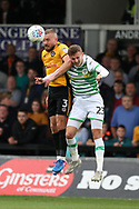 Dan Butler of Newport county (l) jumps for a header with Tom James of Yeovil Town ® . EFL Skybet football league two match, Newport county v Yeovil Town at Rodney Parade in Newport, South Wales on Saturday 7th October 2017.<br /> pic by Andrew Orchard,  Andrew Orchard sports photography.