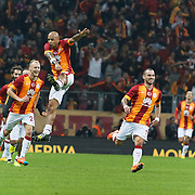 Galatasaray's Wesley Sneijder (R) celebrate his goal with team mate during their Turkish superleague soccer derby match Galatasaray between Fenerbahce at the AliSamiYen spor kompleksi TT Arena in Istanbul Turkey on Saturday, 18 october 2014. Photo by Aykut AKICI/TURKPIX