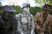 Living statue street performers hanging out during a break from standing still. The South Bank is a significant arts and entertainment district, and home to an endless list of activities for Londoners, visitors and tourists alike.