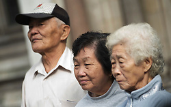 © London News Pictures. 08/05/2012. London, UK. L to R Loh Ah Choi, Chong Koon Ying and Lim Ah Yin , Family of Malaysians killed by British soldiers arriving at The High Court in London on May 08, 2012. The Family members of 24 villagers killed by UK troops  when Malaya was part of the British Empire are seeking an inquiry into their deaths which they claim were 'cold-blooded mass murder'. The judicial review is to be held on 8th and 9th of May. Photo credit: Ben Cawthra/LNP