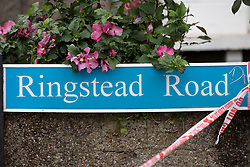 © Licensed to London News Pictures. 18/08/2018. Catford, UK. Police cordon tape is tied to the Ringstead Road sign  where a man in his 50's has been stabbed to death in Catford, south London. Police were called at 4am, the victim was pronounced dead at the scene at 5.28am. No arrests have been made. Photo credit: Peter Macdiarmid/LNP