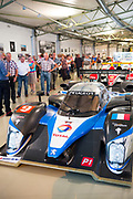 Visitors view Peugeot 908 HDI FAP 2009 diesel race car at the exhibition musee at Le Mans Racetrack, France