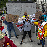 A Black Lives Matter protestor holds her placards in front of Winston Churchill statue meanwhile some right-wing protestors say they're protecting Churchill's statue during a rally in Parliament Square in London, Tuesday, June 9, 2020. Anger against systemic levels of institutional racism has raged through the city, and worldwide; sparked by the death of George Floyd, who was killed in Minneapolis, US, by a policeman who restrained him with force on 25 May 2020. (Photo/ Vudi Xhymshiti)