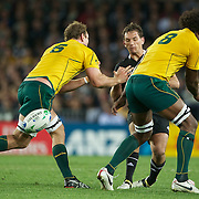 Aaron Cruden, New Zealand, kicks between Rocky Elsom, (left) and Radike Sam0, Australia,  during the New Zealand V Australia Semi Final match at the IRB Rugby World Cup tournament, Eden Park, Auckland, New Zealand, 16th October 2011. Photo Tim Clayton...