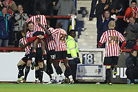 Football - League One - Brentford vs. Oldham<br /> Harlee Dean hugs Clayton Donaldson (no.9) after Marcus Bean scored Brentford's opening