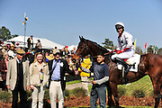 27 March 2010 : Brian Crowley and ARCADIUS in the winners circle with connections after taking the Woodward Kirkover hurdle race at the Carolina Cup.