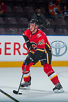 PENTICTON, CANADA - SEPTEMBER 8: Juuso Valimaki #42 of Calgary Flames skates with the puck against the Edmonton Oilers on September 8, 2017 at the South Okanagan Event Centre in Penticton, British Columbia, Canada.  (Photo by Marissa Baecker/Shoot the Breeze)  *** Local Caption ***