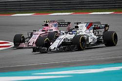 October 1, 2017 - Sepang, Malaysia - Motorsports: FIA Formula One World Championship 2017, Grand Prix of Malaysia, ..#19 Felipe Massa (BRA, Williams Martini Racing), #31 Esteban Ocon (FRA, Sahara Force India F1 Team) (Credit Image: © Hoch Zwei via ZUMA Wire)