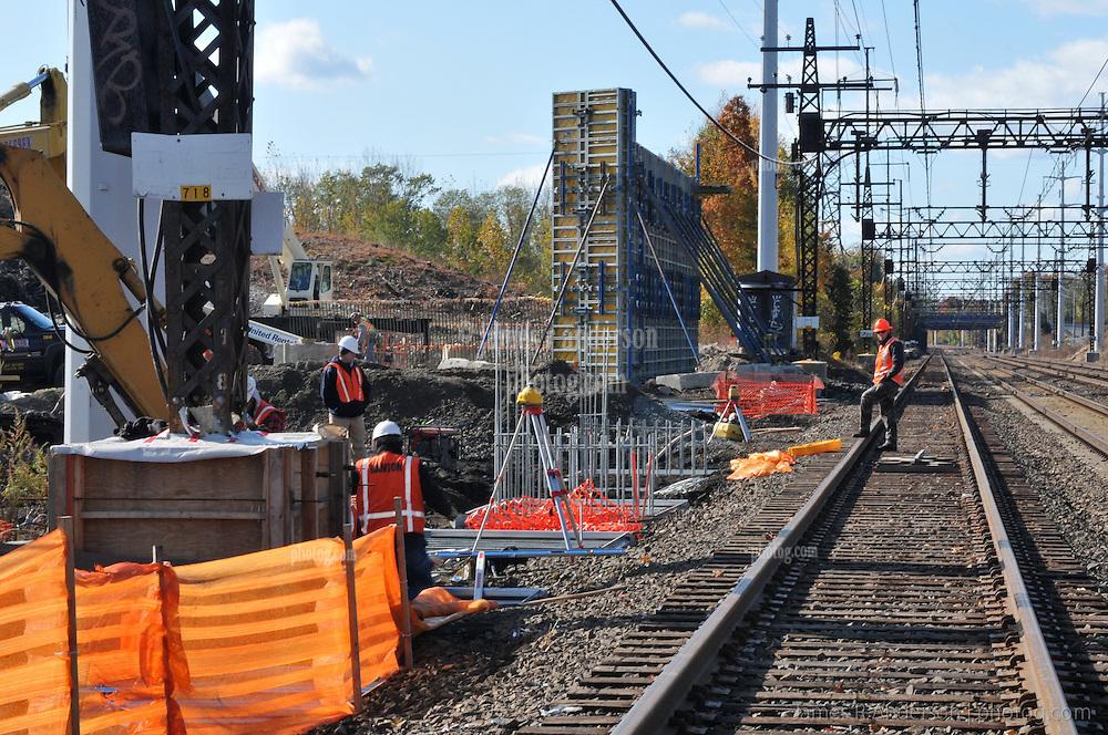 Setting Platform Foundations at Catenary Location. Railroad Station at Fairfield Metro Center CT. Flagman on Tracks, Northeast Corridor.