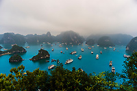 High angle view of Halong Bay from Ti Top Island, North Vietnam filled with tour boats. The bay features 3,000  limestone and dolomite karsts and islets in various shapes and sizes sprinkled over 1,500 square kilometers. It offers a wonderland of karst topography. It is a UNESCO World Heritage Site.