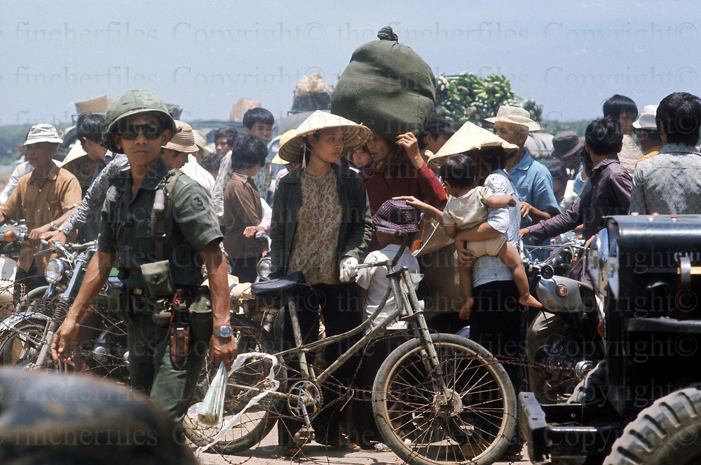 Vietnamese refugees fleeing on the road from Xuan Loc to Saigon as the communist North Vietnamese fores advance. April 1975. Photograph by Terry Fincher
