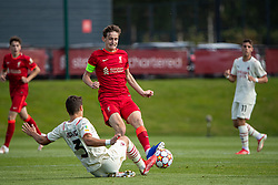LIVERPOOL, ENGLAND - Wednesday, September 15, 2021: Liverpool's captain Tyler Morton is tackled by AC Milan's Milos Kerkez during the UEFA Youth League Group B Matchday 1 game between Liverpool FC Under19's and AC Milan Under 19's at the Liverpool Academy. Liverpool won 1-0. (Pic by David Rawcliffe/Propaganda)