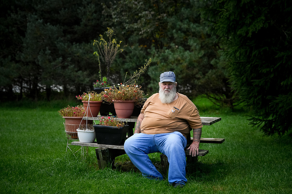 Duke Devlin poses for a portrait with his garden behind his house in Cochecton, N.Y. on October 7, 2018. Devlin is a site interpreter at the Woodstock Museum in Bethel; he attended the 1969 Woodstock Festival, and never left the area.