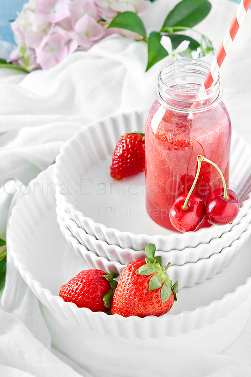 Smoothie of cherries and strawberries.