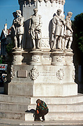 A depressed-looking 1990s man sits beneath statues - paid for public subscriptions and dated 1867 - in Praca Luis Camoes, on 21st March 1994, in Lisbon, Portugal. (Photo by Richard Baker / In Pictures via Getty Images)
